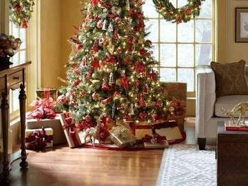 Christmas tree decorated - In many cultures, the tree, especially coniferous, is considered a symbol of life and rebirth, conti