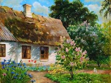 Dom w ogrodzie z kotem