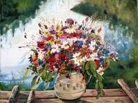Μια στάμνα με λουλούδια