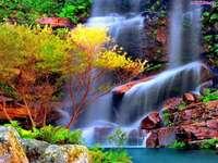 скали, цветни растения, водопад