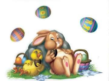 Pasqua - Wielkanocny zając i kurczaczek jedzą czekoladowe jajeczka.
