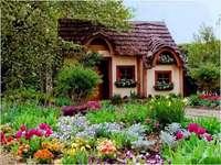 Ett saga hus i blommor