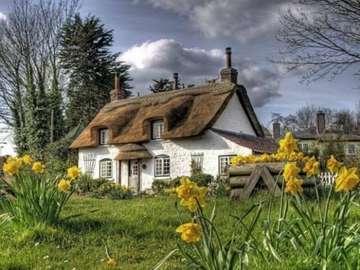 Na angielskiej wsi - Stary dom angielski wśród kwiatów