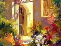 Cancello colorato - Ingresso alla casa in fiori.