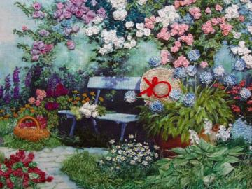 A garden with flowers and a be - Garden with flowers and a blue bench