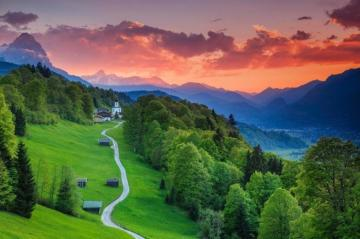 Landscape from Bavaria - Orange-pink sky, mountain peaks, green hills, lane, trees - all of this can be found in Bavaria. Bav