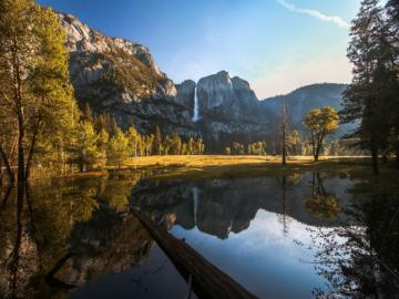 Yosemite National Park - Mountains reflecting off the water's surface. A national park located in the USA, in central Ca