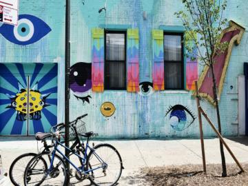 New York City -Bikes - One of New York's streets. Colorful houses with hand-held shutters, bicycles. The most populous