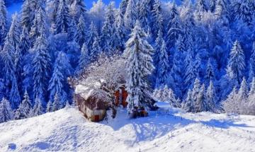 House in mountains - snowy mountain landscape