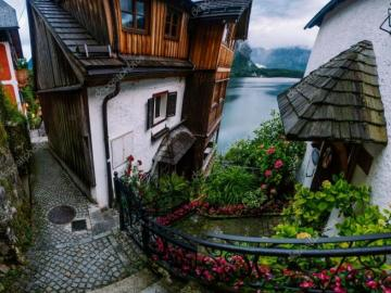 a charming street - houses, water, mountains, flowers