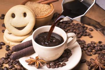 something sweet - a cup of coffee and a smiling ciacho