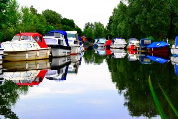 Boats on the canal. - Colorful boats on the canal.