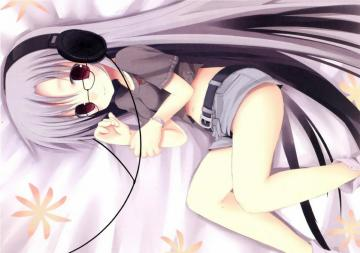 a girl listening to music - a girl on her bed listening to music
