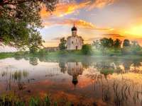 Orthodox. - Orthodox church by the river at sunset.