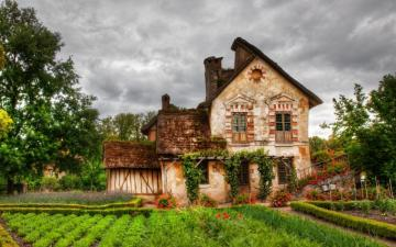 Old house. - An old house surrounded by trees and a garden.