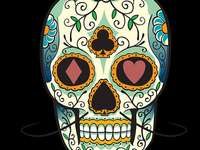 Mexican skull - And a skull that has many flowers in the face and has a mustache