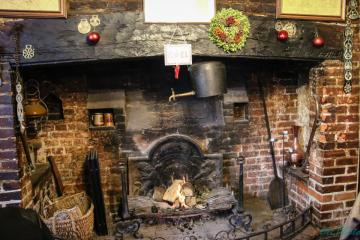 A fireplace in the pub. - A fireplace in a sixteenth-century pub in Chilham, England.