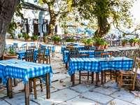 Greek atmosphere. - Landscape: Greek restaurant.
