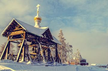 Belfry near the church. - Russian harsh winter. There as winter it is and snow and cold.