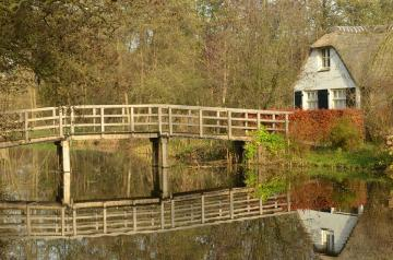 Ankeveen in the Netherlands. - Bridge over a canal in the Netherlands. The landscape is still autumn.