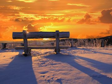 A bench with a view. - Sunset over the valley.