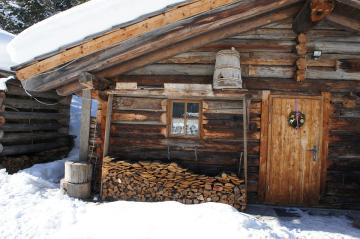 Wooden hut. - And on the door, a festive accent.