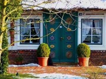 House in the countryside. - Interesting door in a country house.