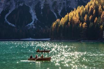 """Boats on the mountain lake - The photo comes from the \ """"Tapeciarnia \"""""""