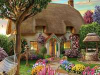 A painted house. - Fairy tale house. A painted house with a garden. Puzzle: a fairy tale house.