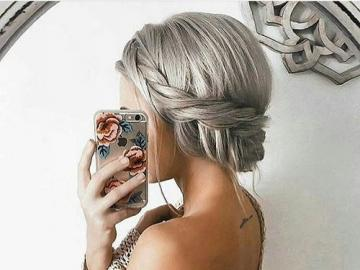 girl with gray hair - Girl with a bun and a braid with gray hair.