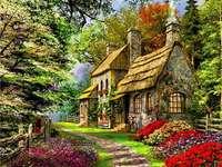 Πέτρινο σπίτι με λουλούδια