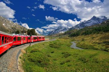 Mountain train - Red train passing below the mountains