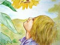 Jongen en zonnebloem bloem.