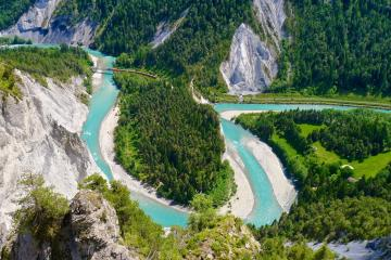 River Rhine landscape - River Rhine meandering through mountain valley