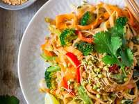Vegan dish - Vegan dish, vegan food - pad thai. Wonders of oriental cuisine.