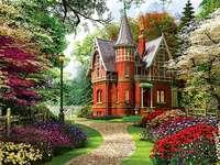 Villa vermelha com um jardim.