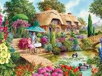 Koppla av i trädgården - Koppla av i trädgården under ett paraply, blommor, damm