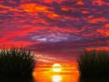 Zachód słońca nad jeziorem . - Zachód słońca nad jeziorem .