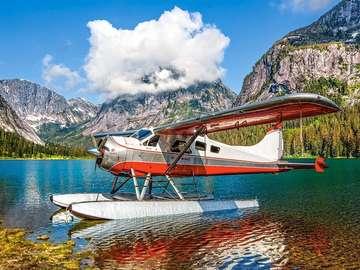 Seaplane on a mountain lake. - Seaplane on a mountain lake.