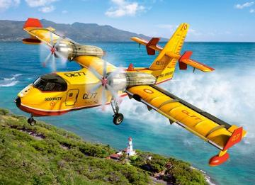 Airplane over land. - Yellow airplane over land.