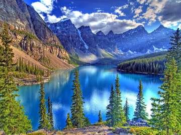 An extraordinary moraine lake - The moraine lake has a large surface, the moraine lake has a low depth, the moraine lake has a devel
