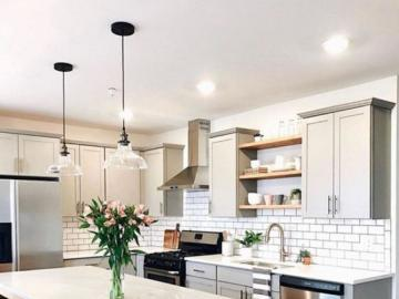 A large kitchen with an island - A large kitchen with an island, an arrangement for the home