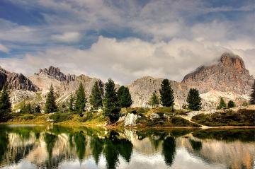 Dolomites - Wonderful landscape of mountains and water.