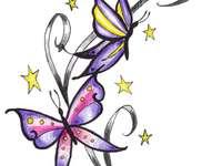 papillons colorés - Papillons colorés dansant sur les fleurs