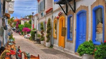 a charming street in Alacati - a charming street in Alacati, colorful doors, flowers