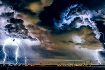 Storm in the sky - Lightning over the city.