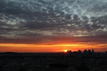 panorama - the last rays of sunshine over Paris captured from the Eiffel Tower