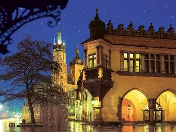 Miasto wieczorową porą. - Kraków po zachodzie słońca. Układanka. Kraków  wieczorem. Kraków o zmroku.