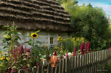 A whitewashed cottage with thatched roof. - A whitewashed cottage with thatched roof.