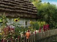 Ένα ασβεστωμένο εξοχικό σπίτι με αχυρένια στέγη. - Ένα ασβεστωμένο εξοχικό σπίτι με αχυρένια στέγη.